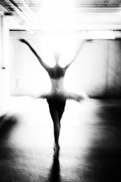 Ballerina dancing in the garage stock photo