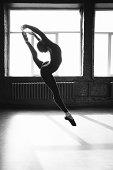 Ballerina dancing indoors.
