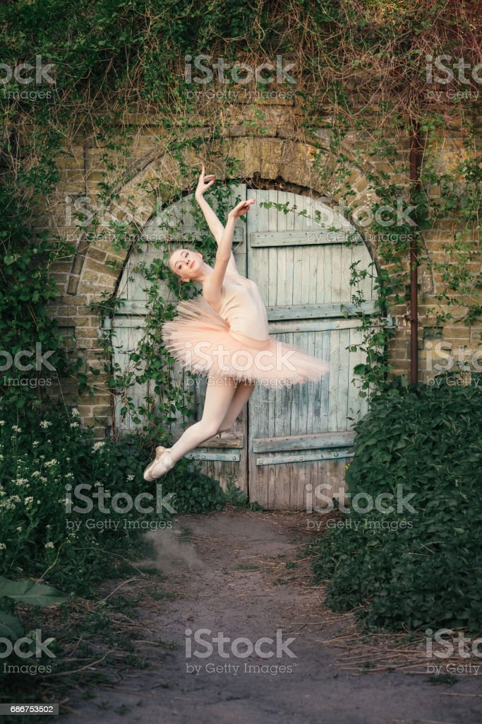 Ballerina Dancing Outdoors Classic Ballet Poses In Urban Background Stock Photo Download Image Now Istock