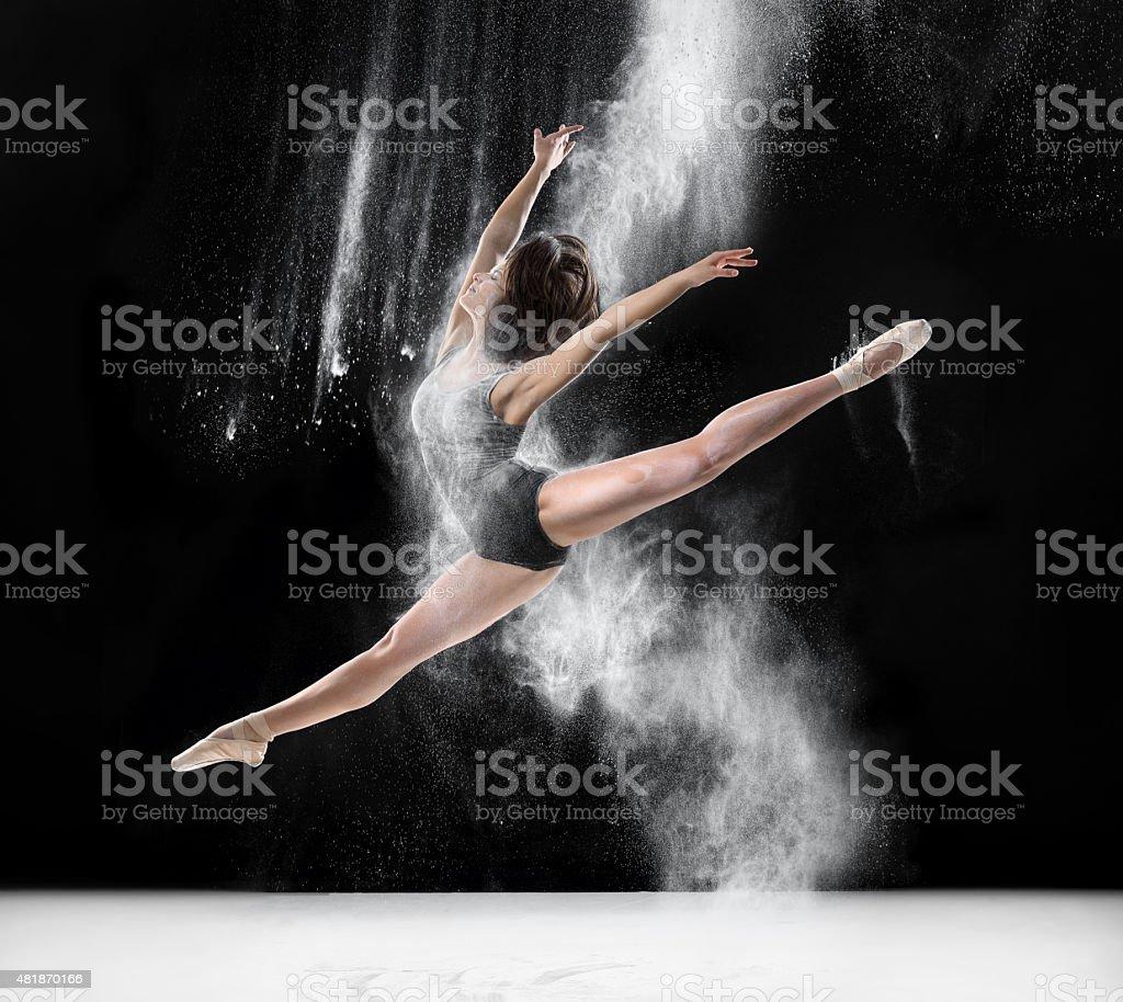 ballerina dancing with flour, jump stock photo