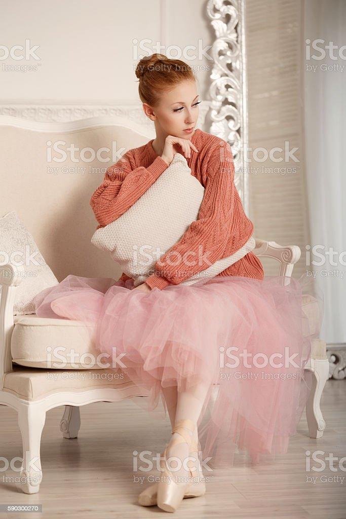 Ballerina grieves hugging pillow royaltyfri bildbanksbilder