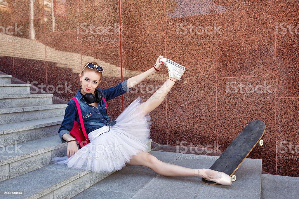 Ballerina hipster sitting on the steps. royaltyfri bildbanksbilder