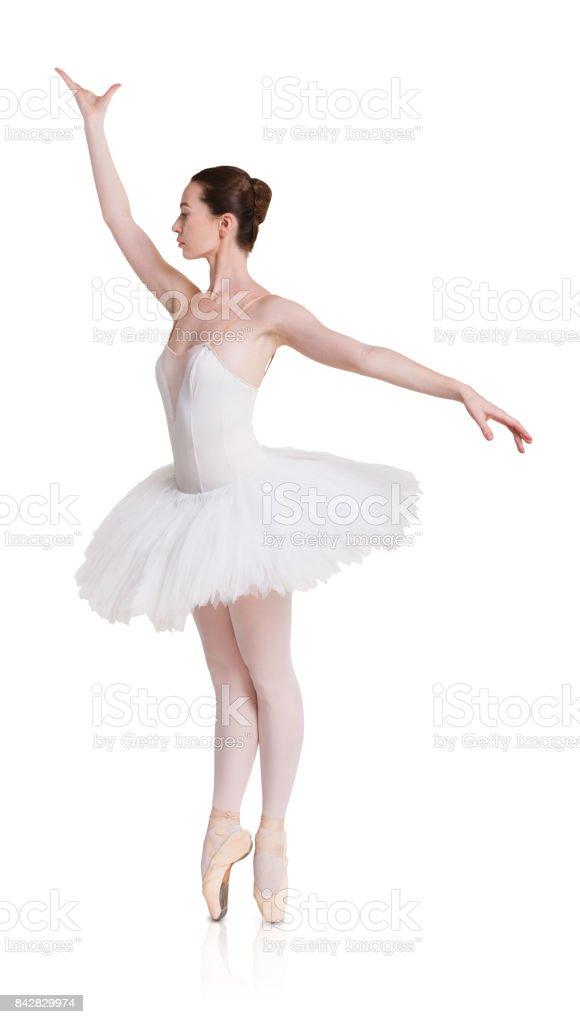 Ballerina in ballet position on white isolated background stock photo