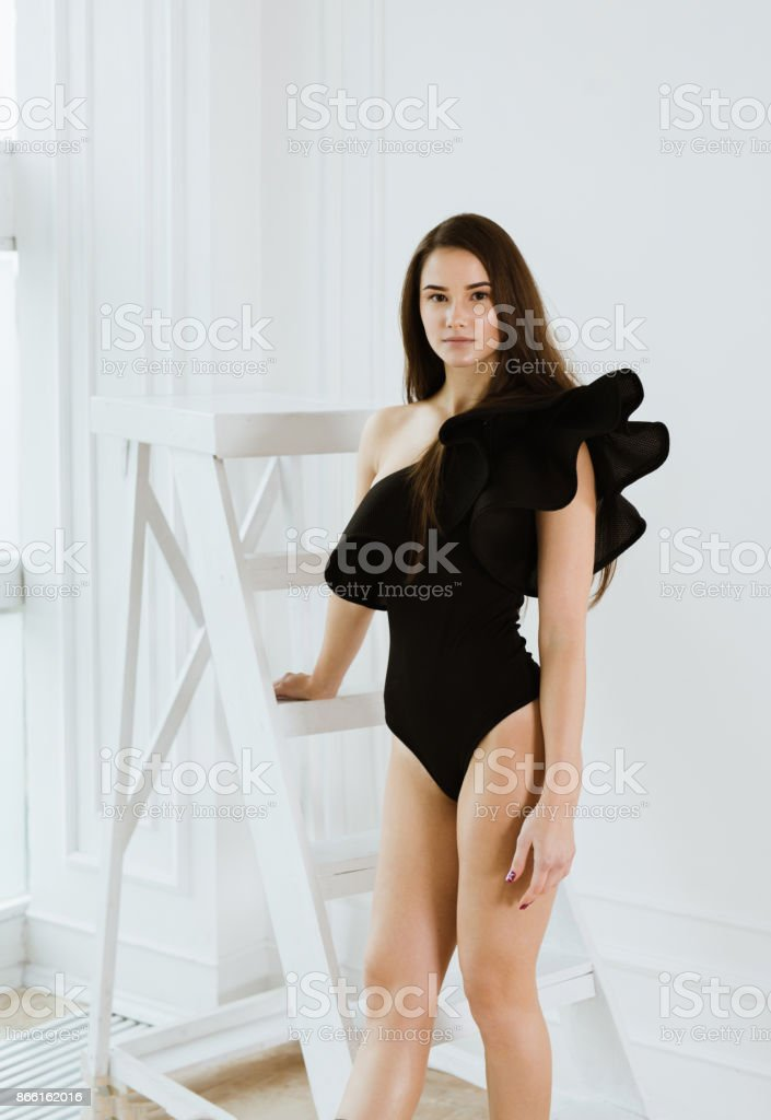 Ballerina in black body is engaged in gymnastics stock photo
