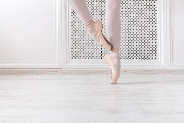 Ballerina in pointe shoes, graceful legs, ballet background stock photo