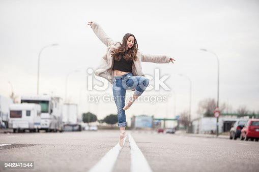 Ballerina dance on the asphalt of the avenue