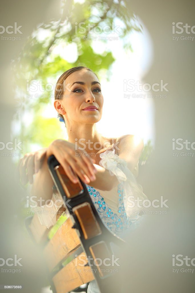 ballerina in the park on a bench royalty-free stock photo