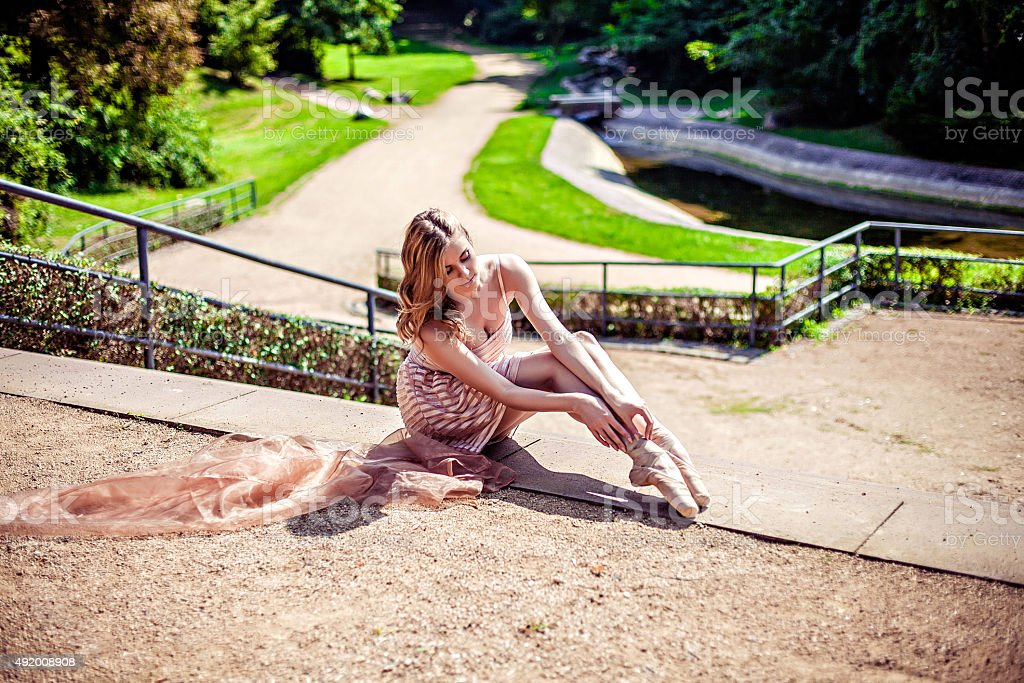Ballerina in the park wearing points stock photo