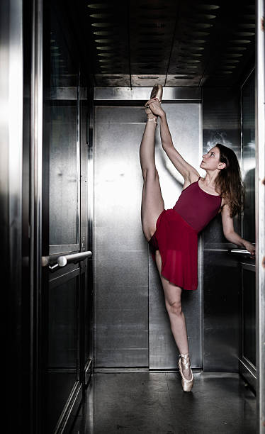 Ballerina inside elevator stock photo