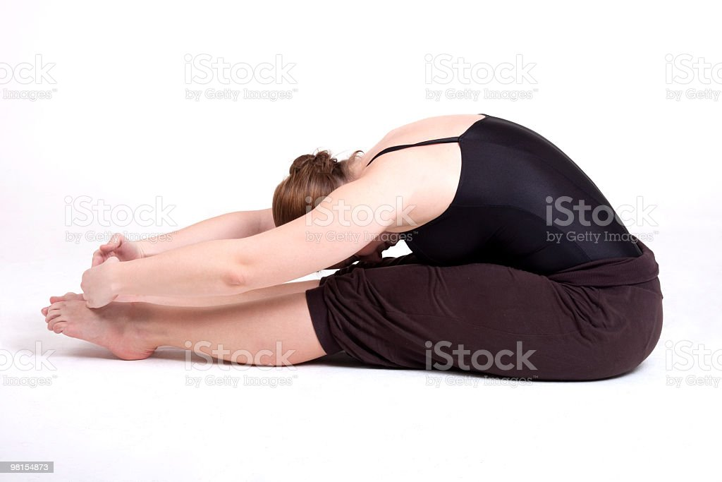 Ballerina leaning over her feet royalty-free stock photo