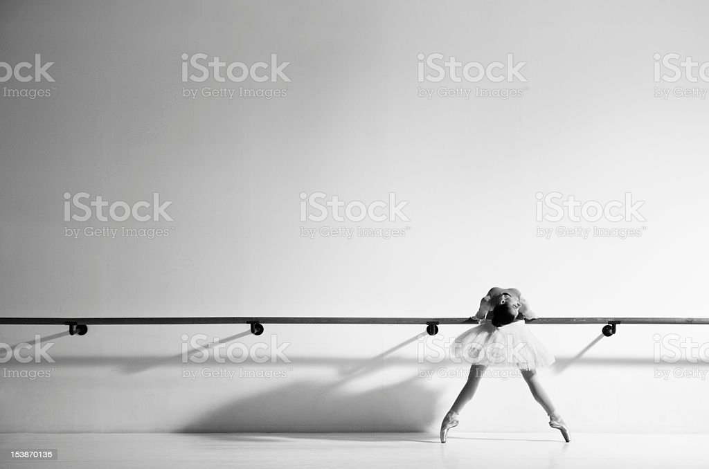 Ballerina next to handle bar stock photo