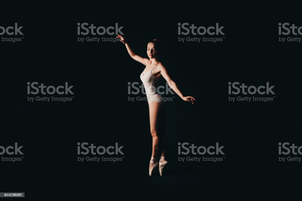 Ballerina on a black background. stock photo