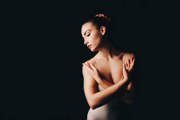 A ballerina on a black background. stock photo