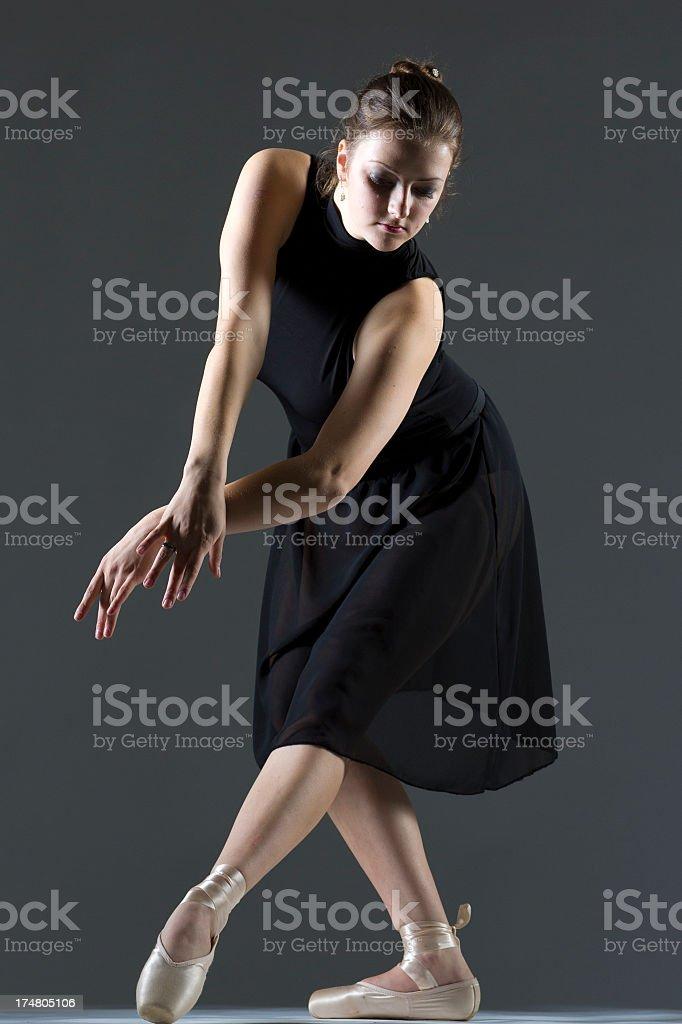Ballerina on a gray background royalty-free stock photo