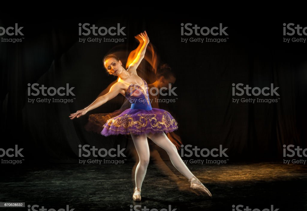 Ballerina on stage with ghosts stock photo