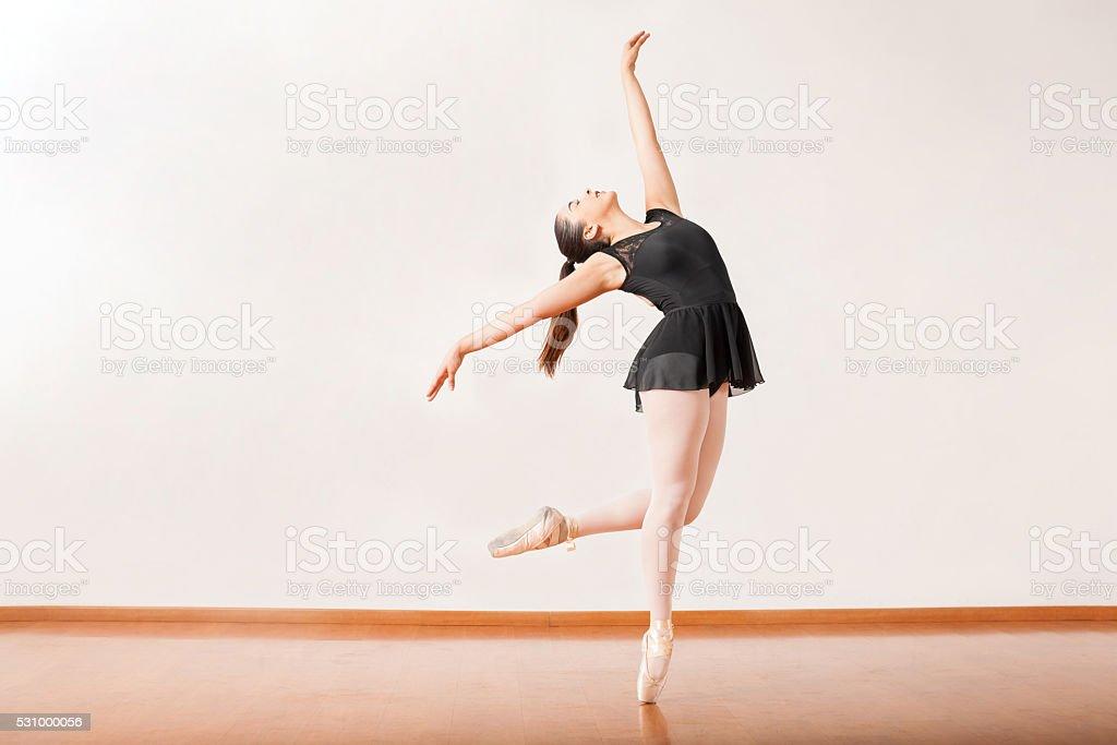 Ballerina performing in a dance studio stock photo