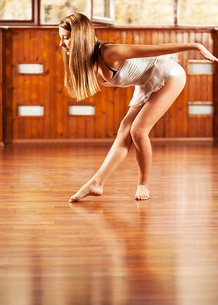 Ballerina posing in a dance studio stock photo