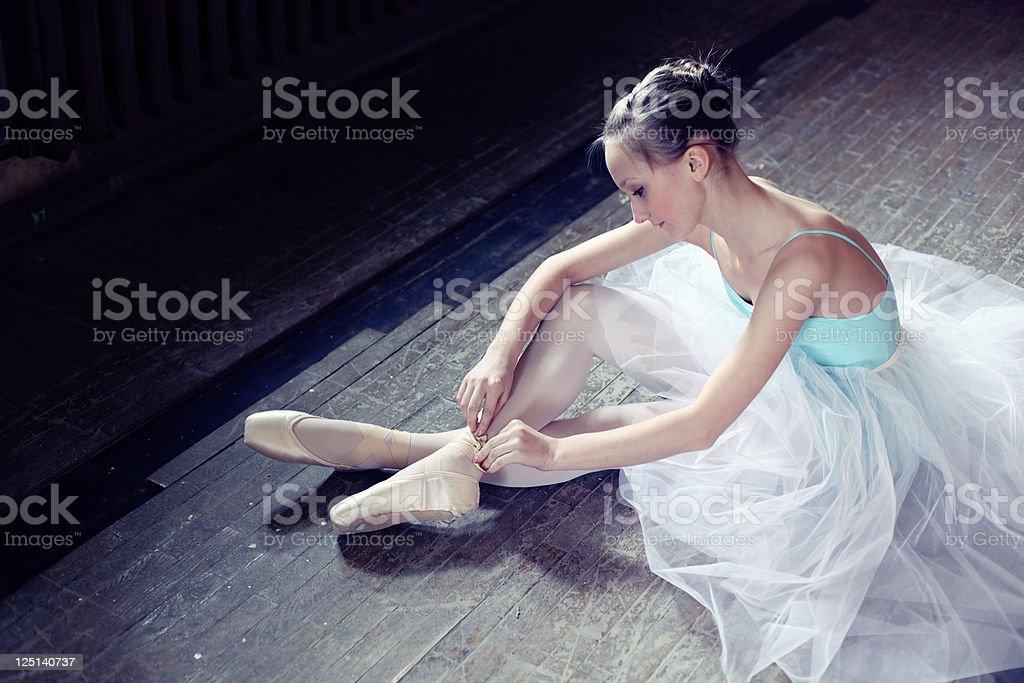 Ballerina putting on pointes stock photo