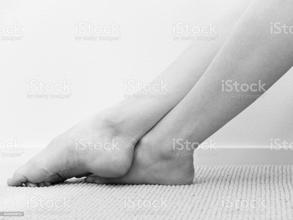 Ballerina resting her feet during break