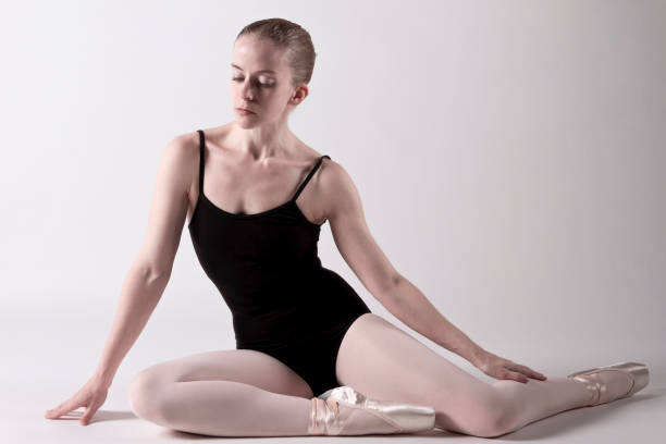ballerina warming up before going on stage - leotard stock pictures, royalty-free photos & images
