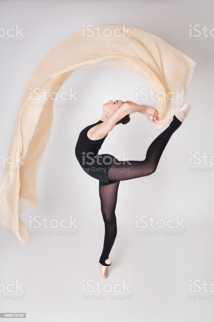 ballerina with air freely flying cloth stock photo