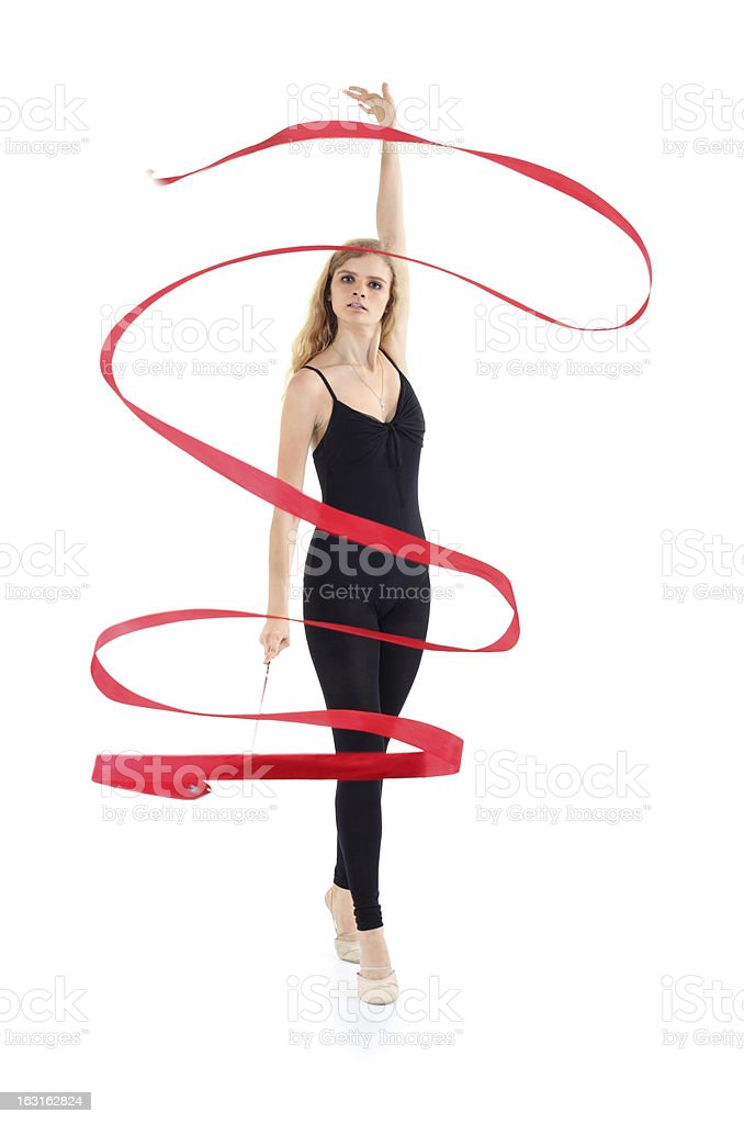 Ballerina with ribbon stands on tiptoe, raises hand up stock photo