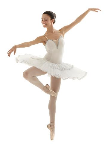 ballerina with white tutu doing the pique pose on white background