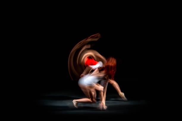 Ballerinas dancing, motion blurred stock photo