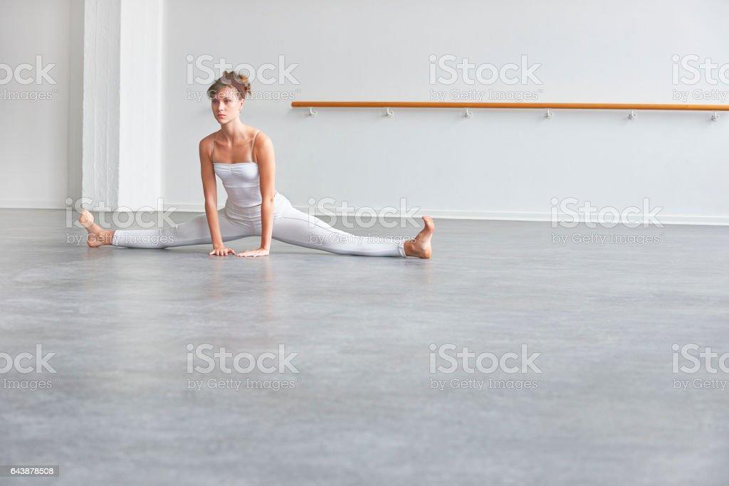 Ballet dancer doing the splits stock photo