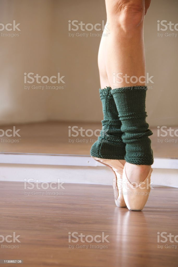 Ballet Dancer Feet On Pointe Shoes With Leg Warmers Stock Photo Download Image Now Istock