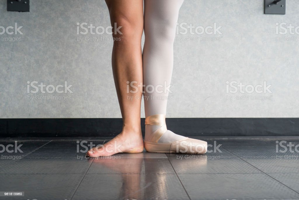 Ballet Dancer In First Position With One Foot In A Pointe Shoe And One Bare Leg Stock Photo Download Image Now Istock