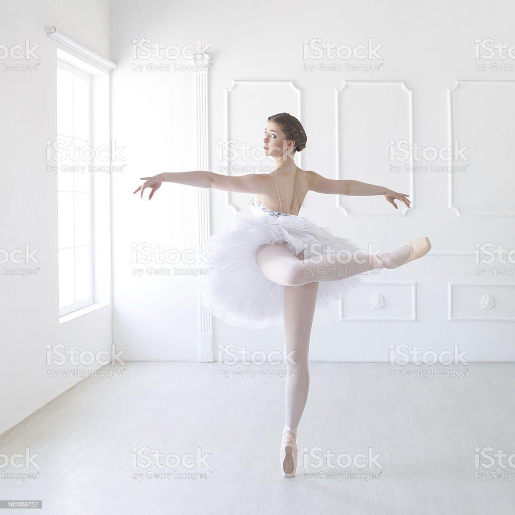 Ballet dancer in white studio stock photo