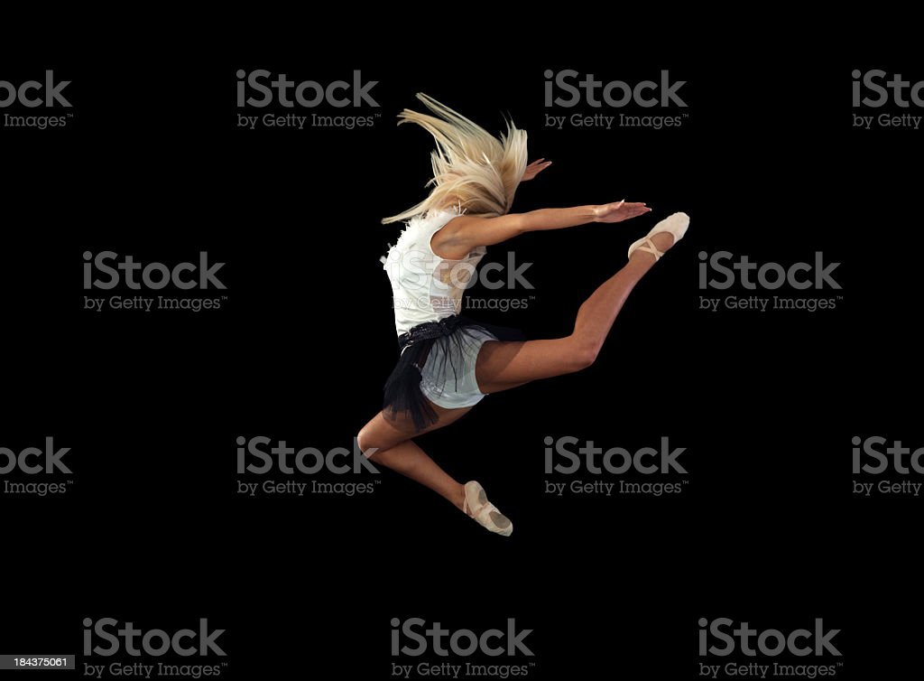 Ballet dancer jumping over isolated black background. royalty-free stock photo