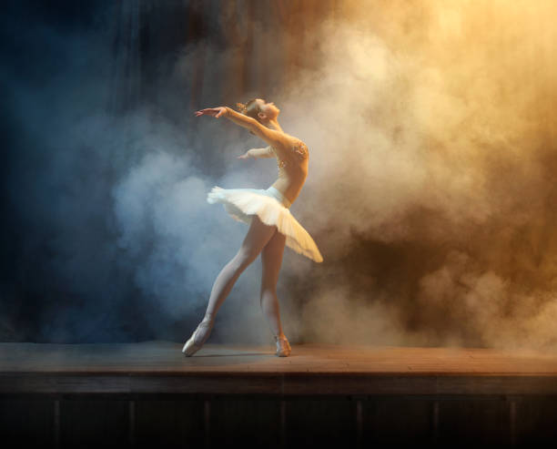 Ballet dancer performing on stage in theate stock photo