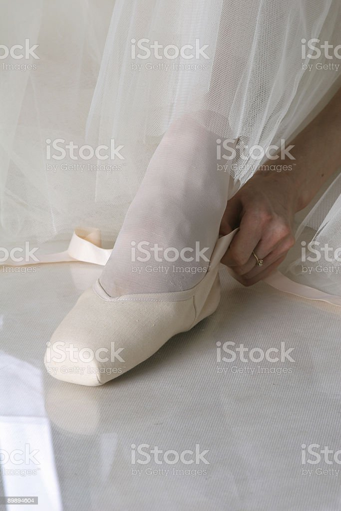 ballet dancer putting on pointes royalty-free stock photo
