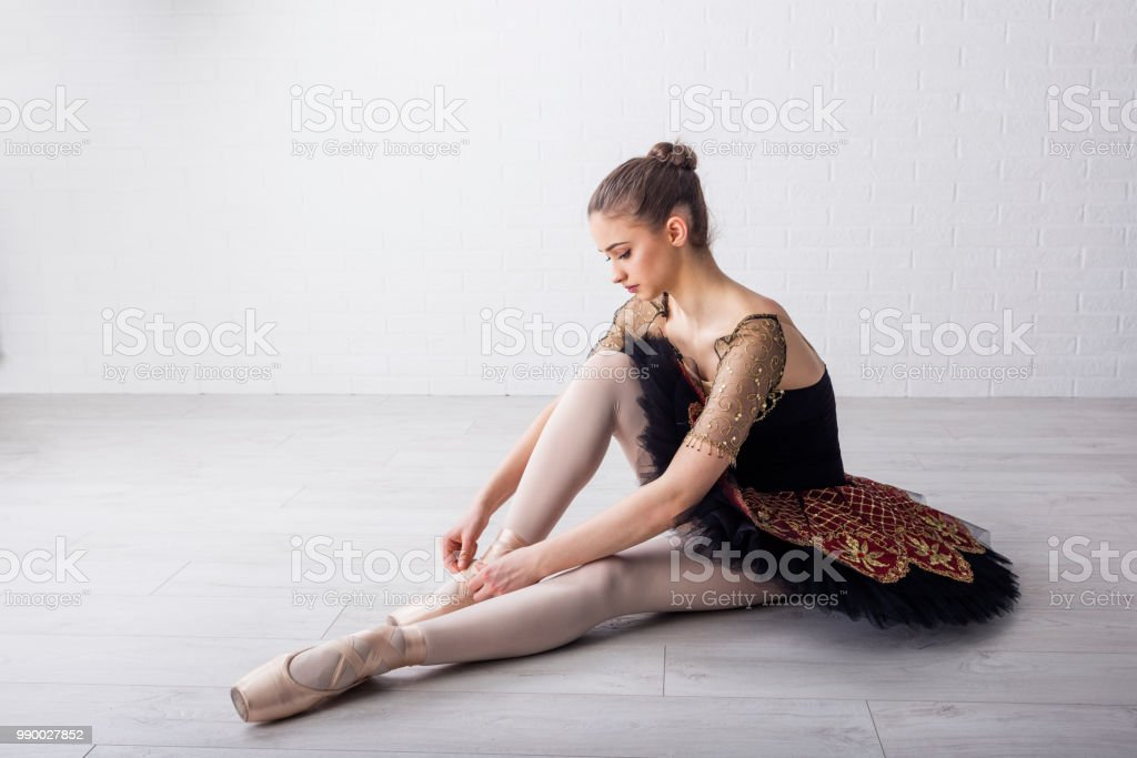Ballet dancer sitting on the floor and prepare for exercise stock photo
