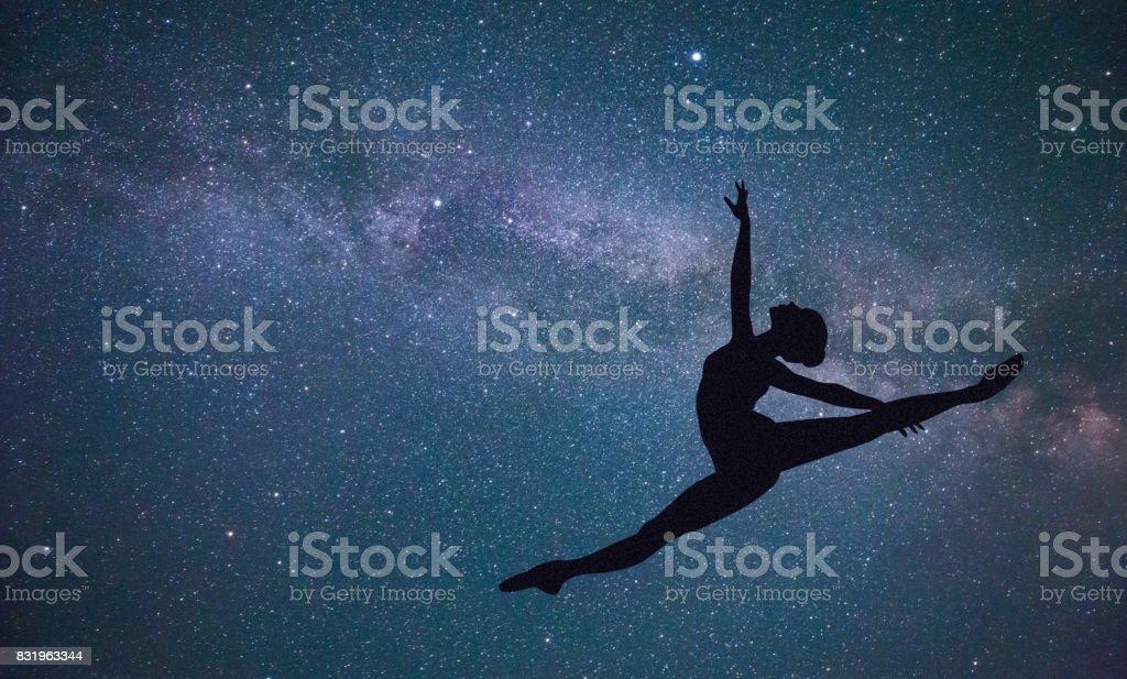 Ballet dancer under the Galaxy stock photo
