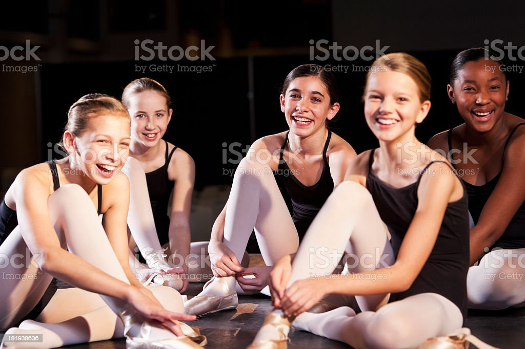 Ballet dancers putting on slippers royalty-free stock photo