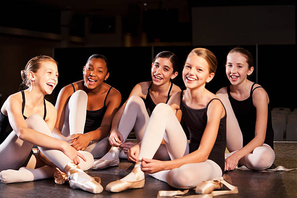ballet dancers putting on slippers - leotard stock pictures, royalty-free photos & images