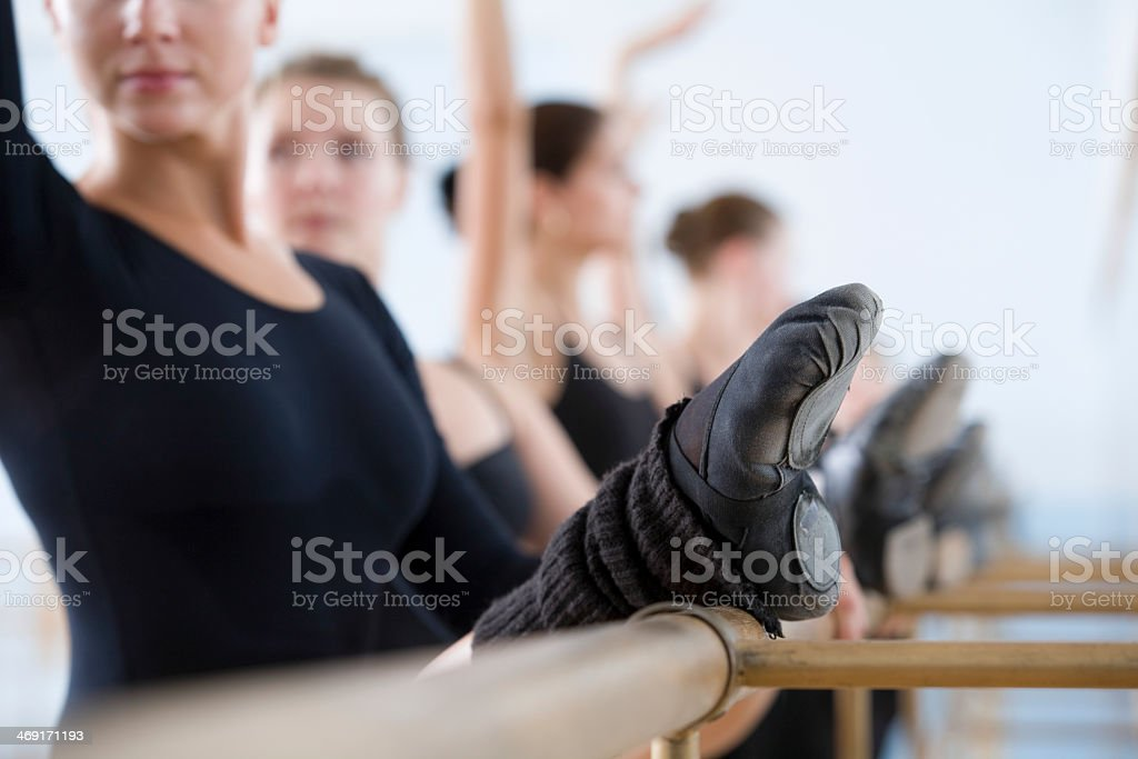 Ballet dancers stretching their legs and practicing stock photo