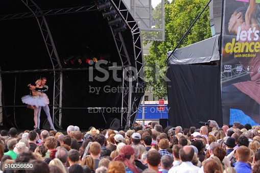 Bristol, England - July 31, 2010: Crowds watching a performance of the ballet Swan Lake in the Dance Village at the city's free three day Harbour Festival