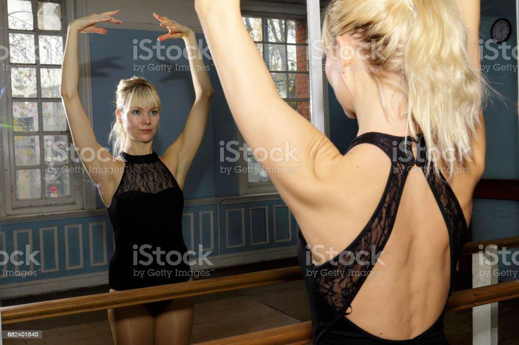 Ballet exercise bar practise mirror reflection Danish ballerina stock photo