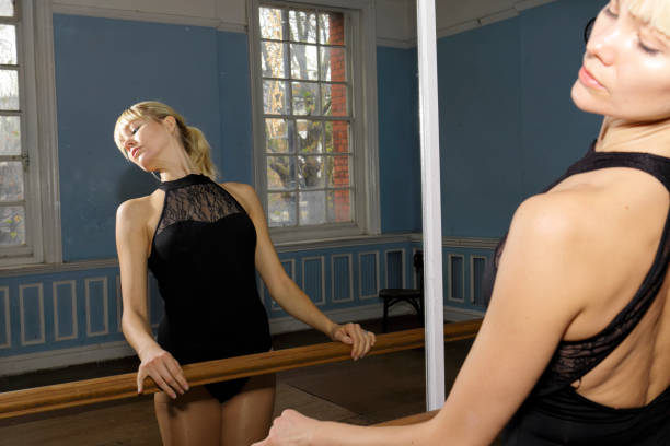 ballet exercise bar practise mirror reflection danish ballerina - whiteway danish stock photos and pictures