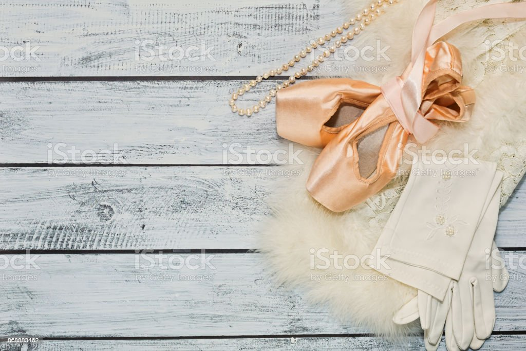 Ballet props on wooden background, top view stock photo