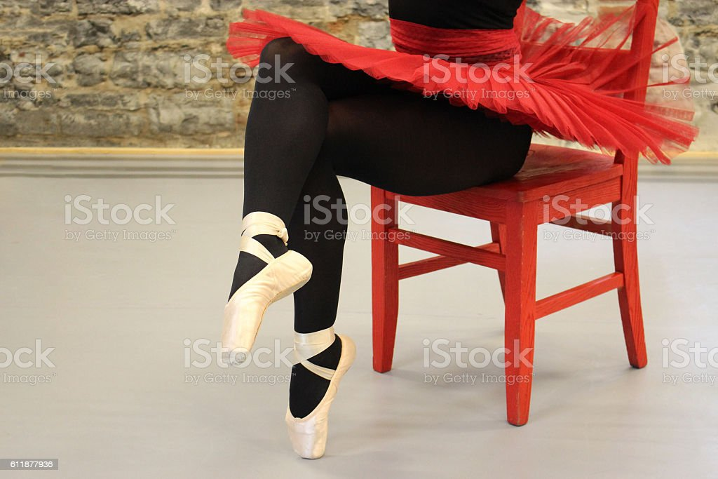 Ballet Shoes and Red Ballerina Tutu On Red Chair stock photo