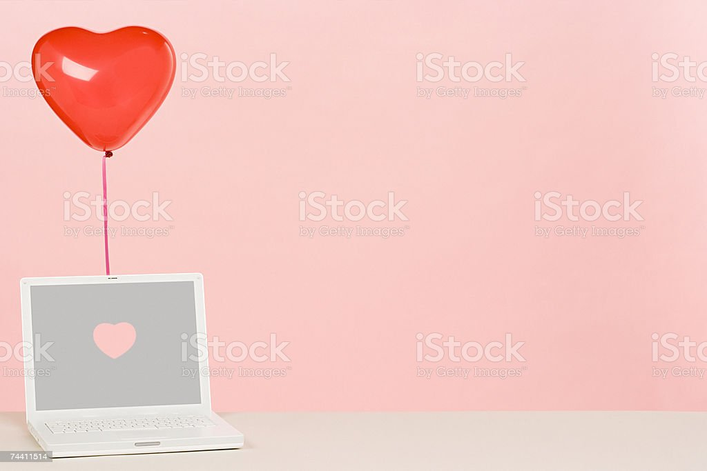Balloon and laptop stock photo