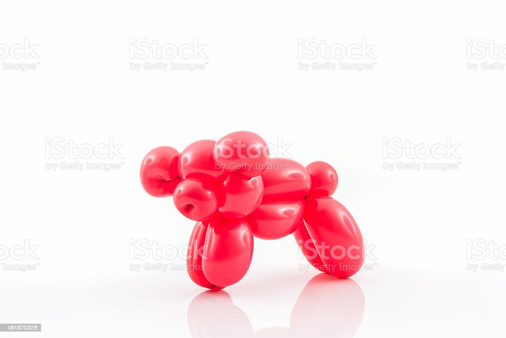 Balloon animal of red pig action pose. stock photo