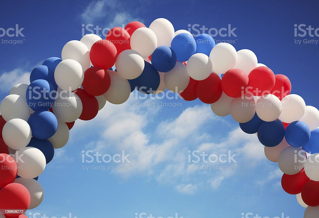 Balloon arch with vivid sky background stock photo
