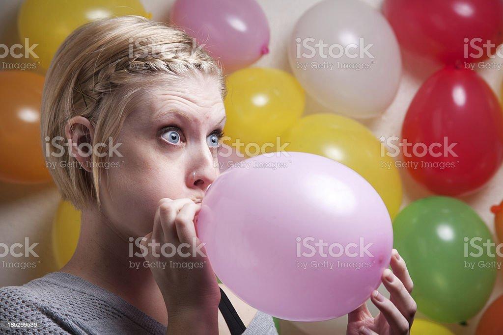 Balloon Blowing Woman stock photo