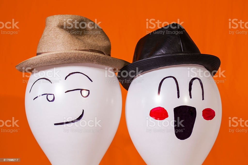 Balloon characters wearing hats stock photo